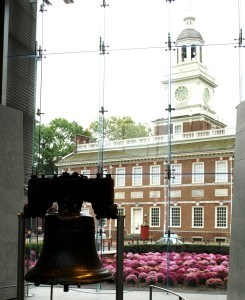 The Liberty Bell in Philadelphia with Independence Hall in the background.